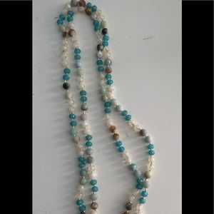 Long stranded beaded necklace